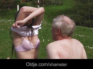 Teen brunette fucks with nudist grandpa in the park