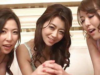 Three Japanese women working one dick