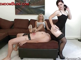 Two mistresses use slave for tongue service femdom