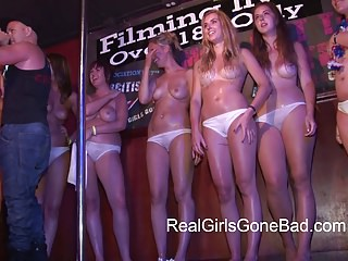 HOT COLLEGE GIRLS STRIPPING ON STAGE FOR A WET T-SHIRT CONTE