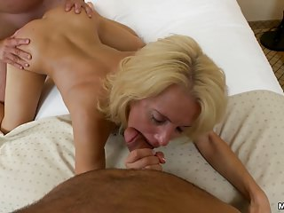 Swinger MILF gets tag teamed
