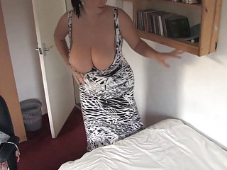 Making bed with boobs-out