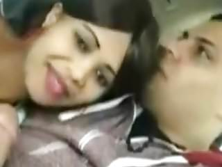 Arab couple in the car. phone 11