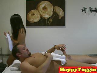Curvy asian masseuse wanking client til cum