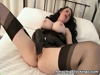 Huge tits slut in stockings and black boots masturbating