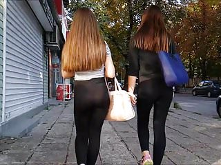 Two sexy butts in transparent yoga pants, slow motion