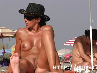 Pretty naked babes at the nudist beach