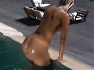 Nude Blonde Model in the Pool