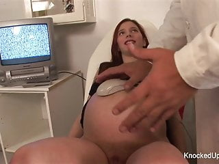 Knocked up redhead sucks and fucks in the doctor's office