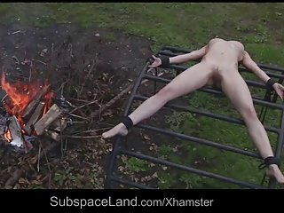 Skinny helpless slave expoited outside by her Master