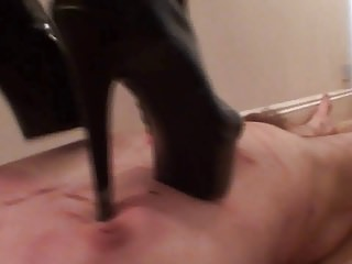 Two mistress trample their slave
