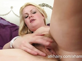 Hairy amateur British blonde Claire enjoys stripteasing.