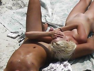 Voyeur. Slim blonde Jerks and her boyfriend at public beach