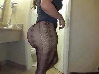 Big ass milf teasing in see thru fishnets