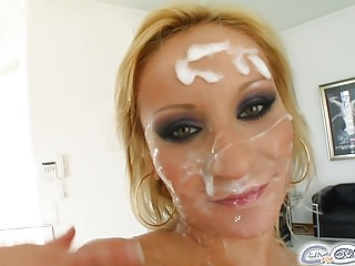 She gets five hard cocks' cum all over her face