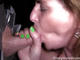 RedHead MILF Sucks Two Cocks in Gloryhole