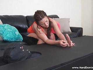 she teases erection with a handjob through gloryhole device