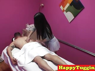 Asian masseuse tugging and fucking client