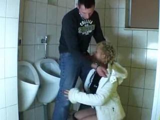 Guy fucks a mature in a public bathroom