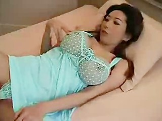 Asian woman with very big tits enjoying a cock