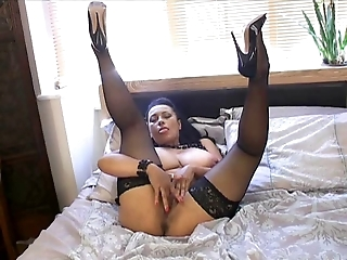British MILF Danica plays with herself on the bed