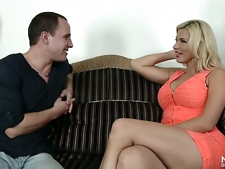 Fine and sultry blonde milf in orange dress feels horny and wants to fuck on the couch
