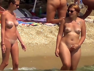 Naturists couple blonde slim female friends tatoo